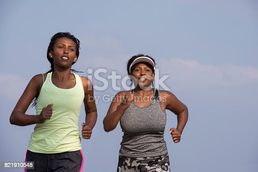istock Women morning fitness exercise. Jogging women running. Female runners during outdoor workout. 821910548