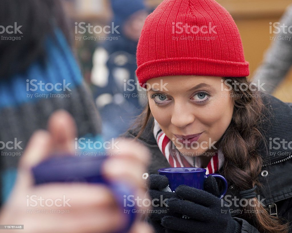 Women on Christmas market drinking punch royalty-free stock photo