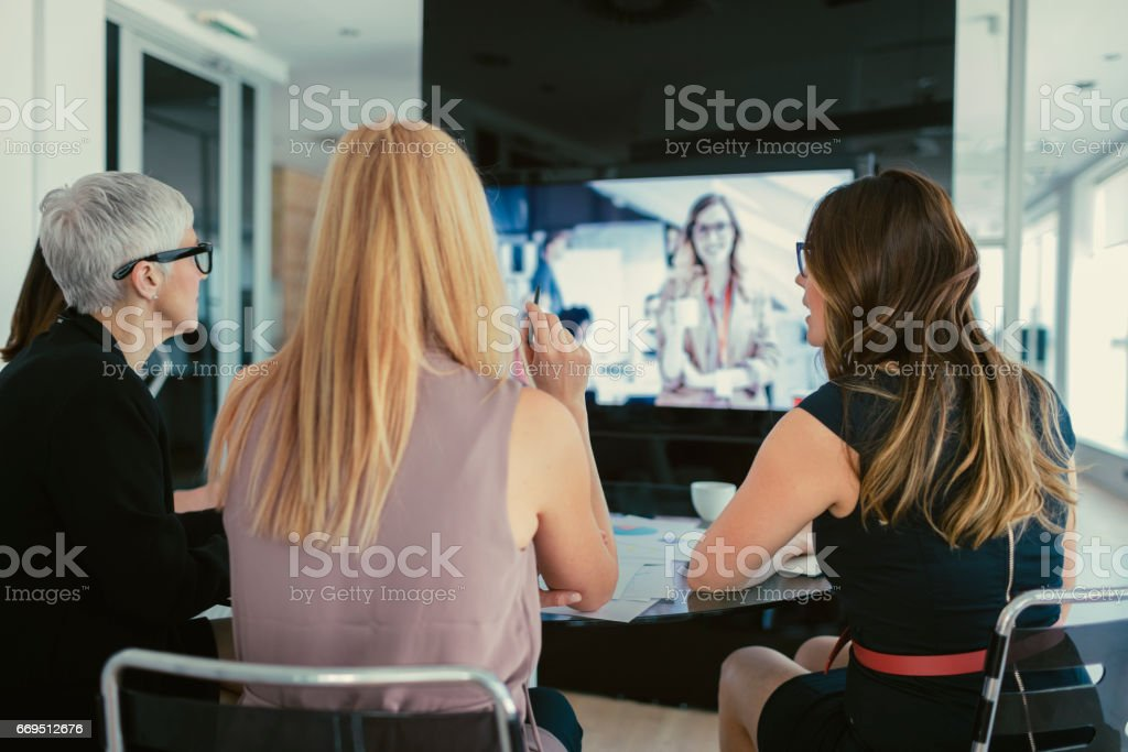Women on conference call stock photo