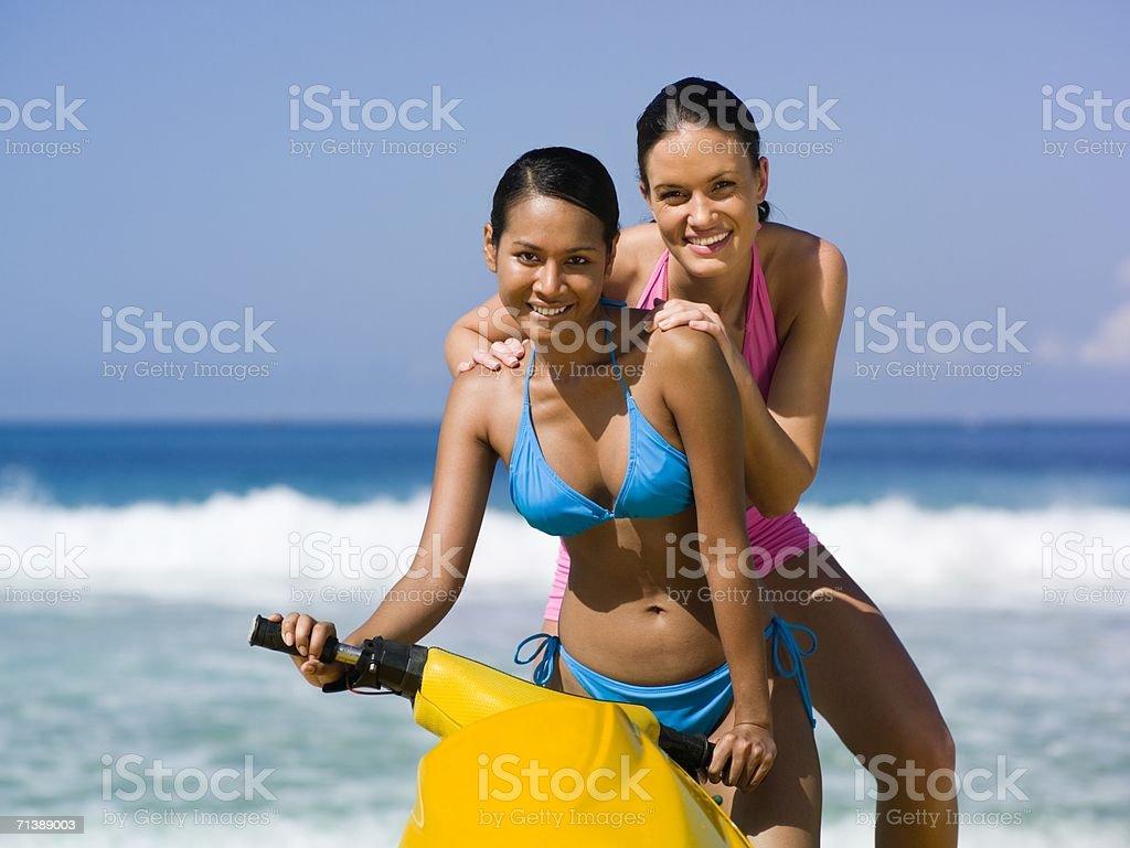 Women on jet ski by the sea royalty-free stock photo