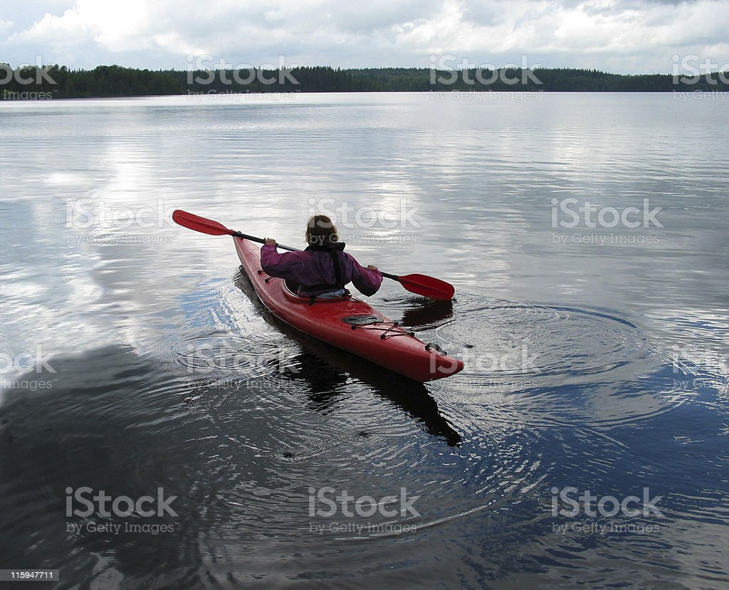 Women on peaceful twilight trip in red kayak royalty-free stock photo