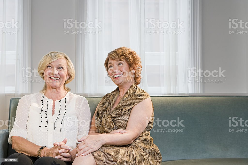 Women on sofa 免版稅 stock photo
