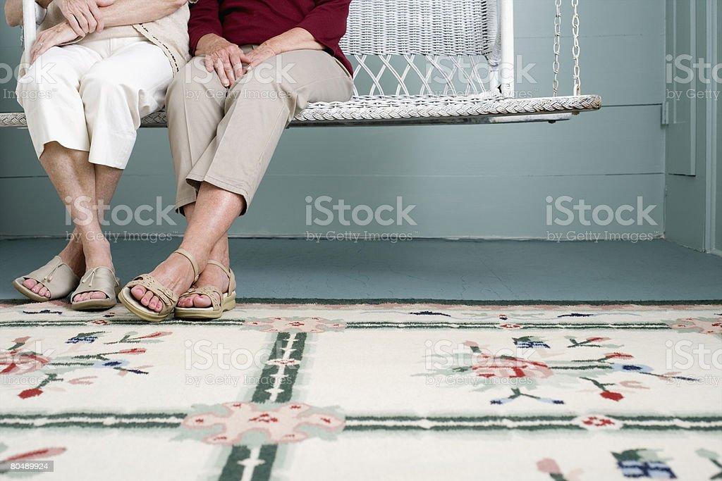 Women on swing seat 免版稅 stock photo