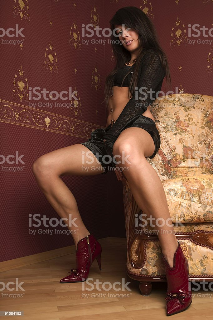 Women on the armchair. royalty-free stock photo