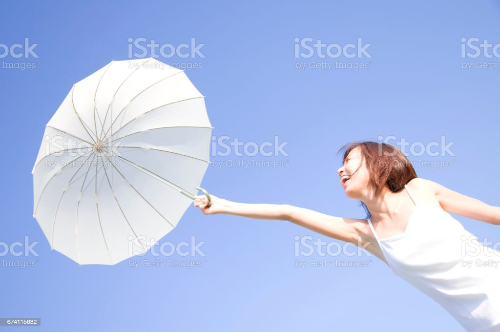 Women on the parasol royalty-free stock photo