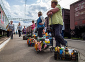 Petrozavodsk, Russia - June 18, 2017: Women on the platform waiting for customers while parking the train  at the railway station Petrozavodsk