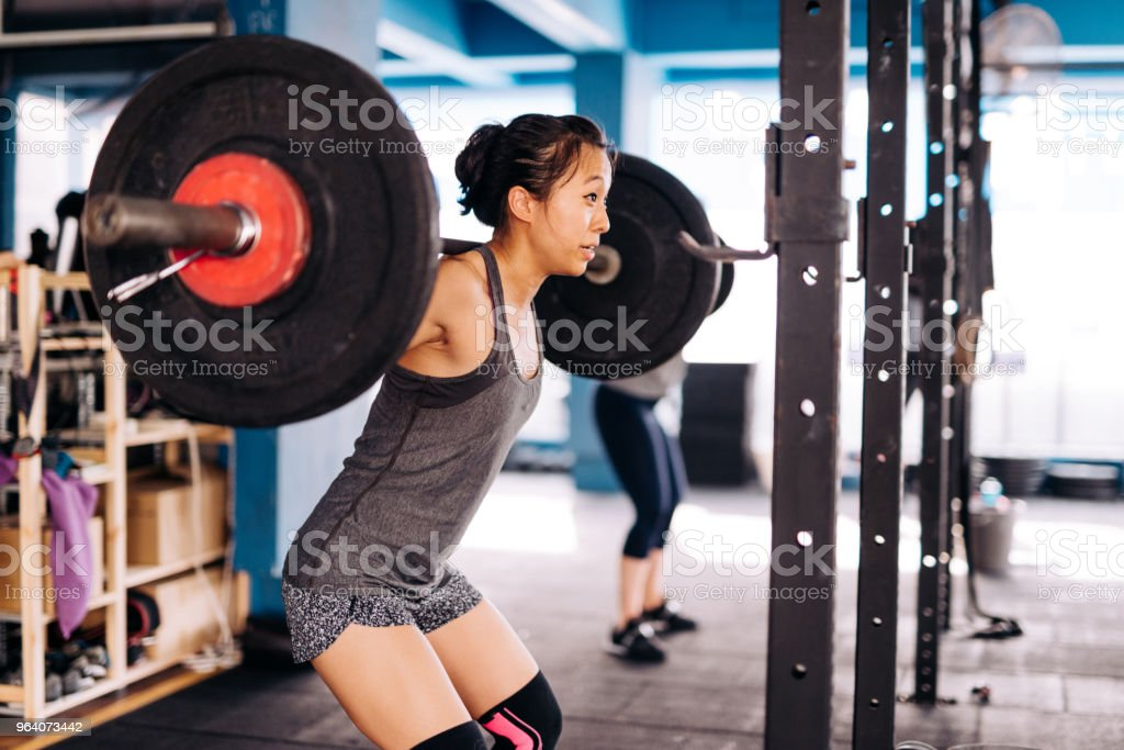 Women on weight training - Royalty-free 20-29 Years Stock Photo