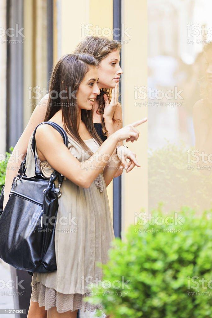 Women on Window Shopping Tour royalty-free stock photo