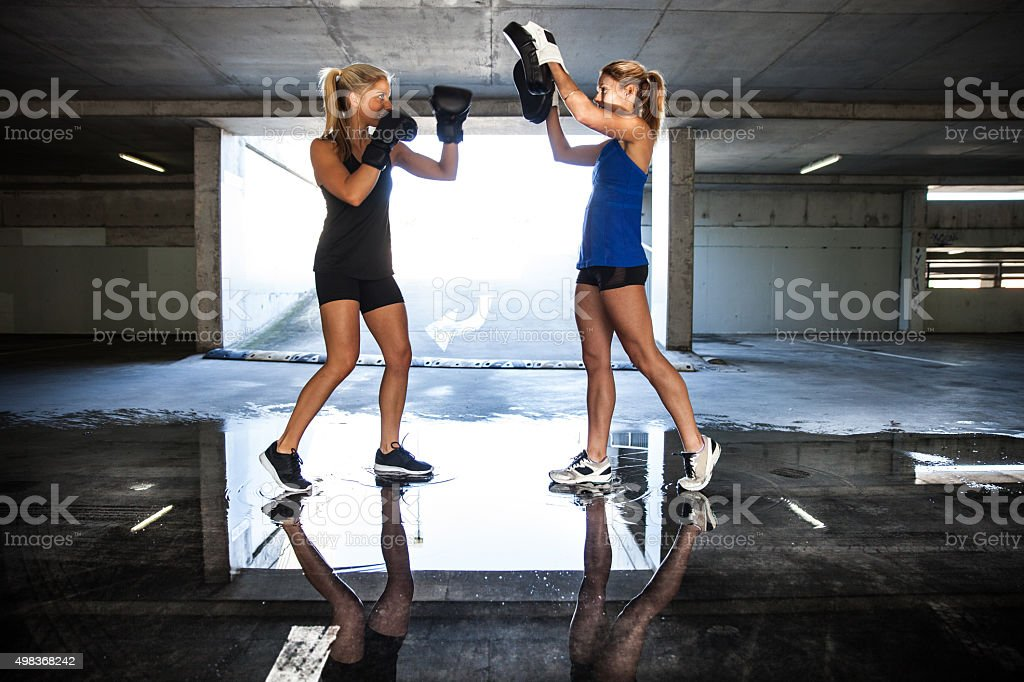 Group of women sport team boxing outdoor inside a multi level parking...