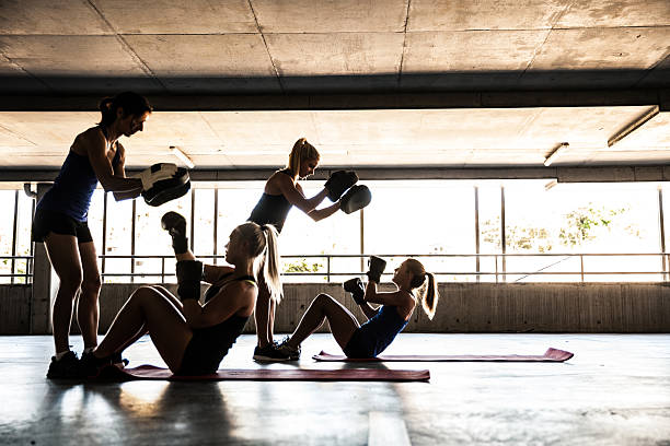 Women only boxing team exercising outdoor stock photo
