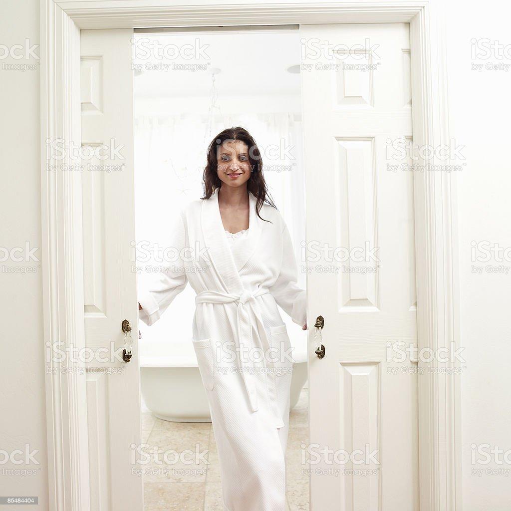 Women opening door to bathroom royalty-free stock photo