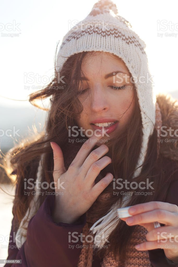 Women outdoor taking care of lips stock photo