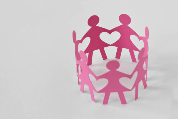 women paper chain on white background - love and unity concept - battle of the sexes concept stock pictures, royalty-free photos & images