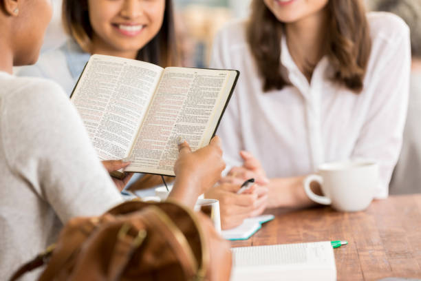 Women participate in Bible study stock photo