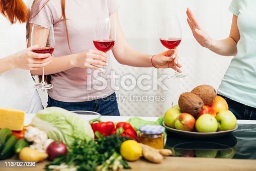 istock women party healthy lifestyle alcohol refuse wine 1137027096