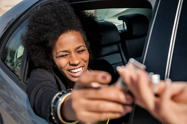 Royalty Free Women Passing Chewing Gum Out Of The Window Car ...