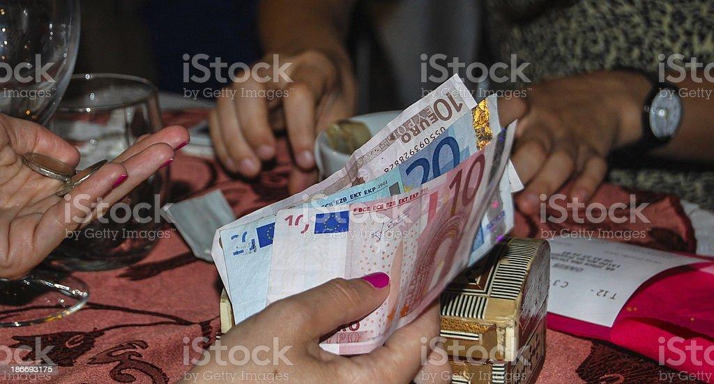 Women paying a bill stock photo
