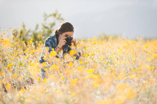 Women photographer in the wild flowers picture id660530280?b=1&k=6&m=660530280&s=612x612&w=0&h= lu1ghp5kxf6ybvrthlcgbdr9illu 3yec 1ais6zaq=