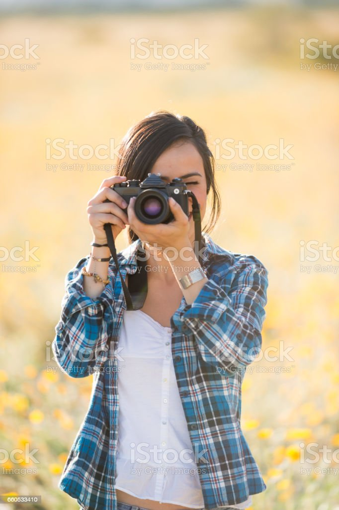 Women Photographer In The Wild Flowers stock photo