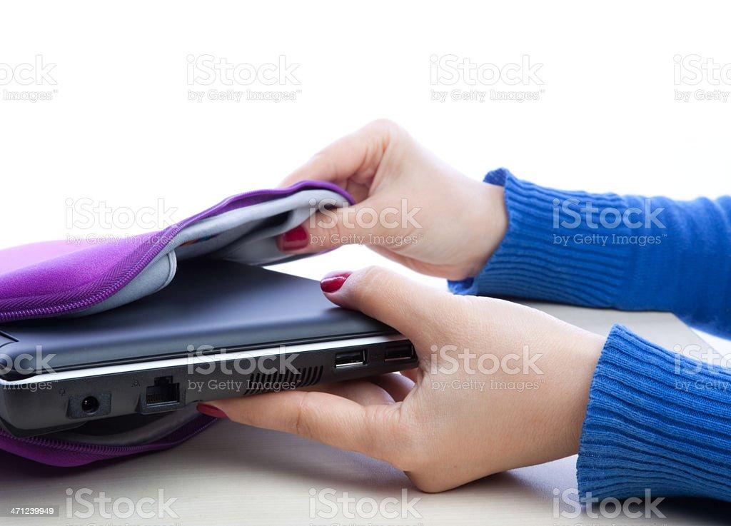 Women picking up her new laptop stock photo