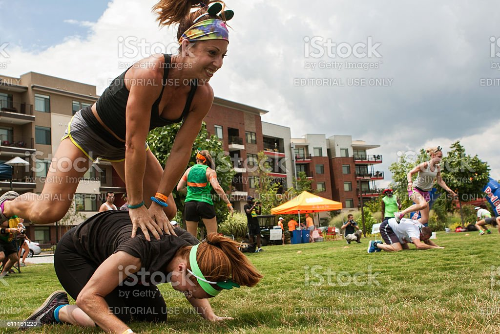 Women Play Leap Frog In Atlanta Field Day Event stock photo