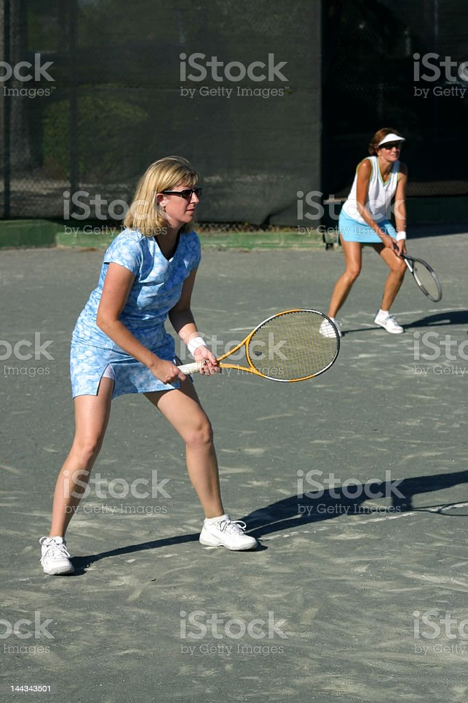 women playing doubles royalty-free stock photo