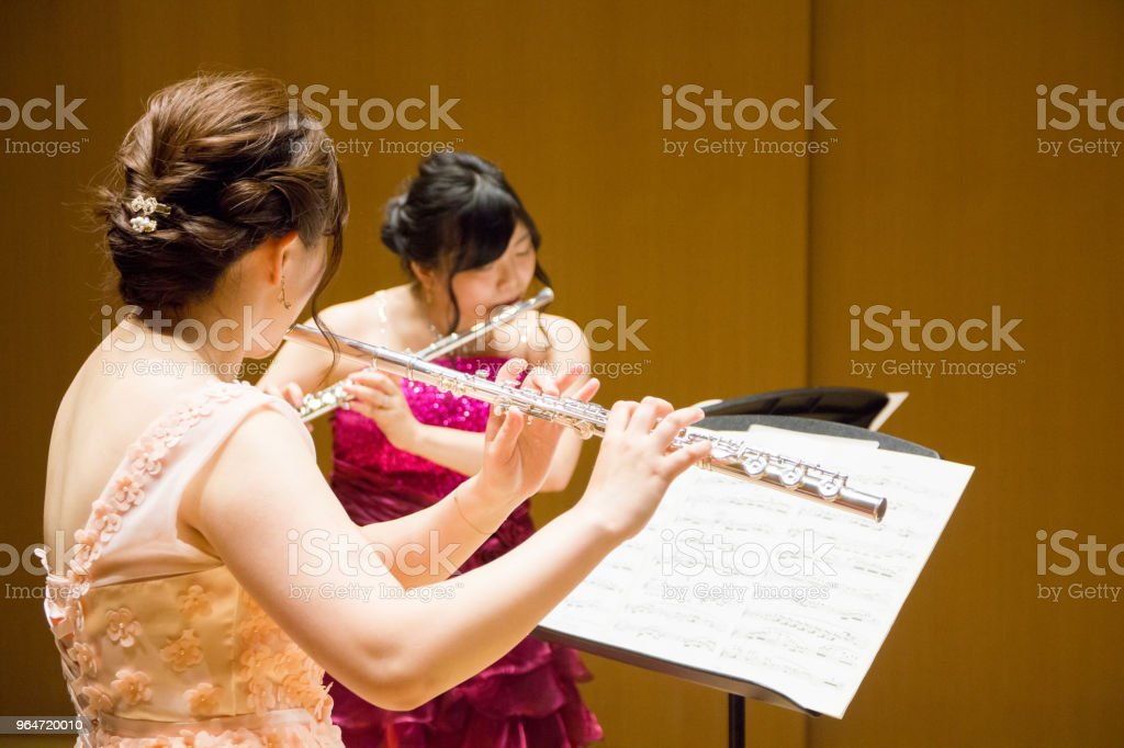 Women Playing Flute in a Concert royalty-free stock photo