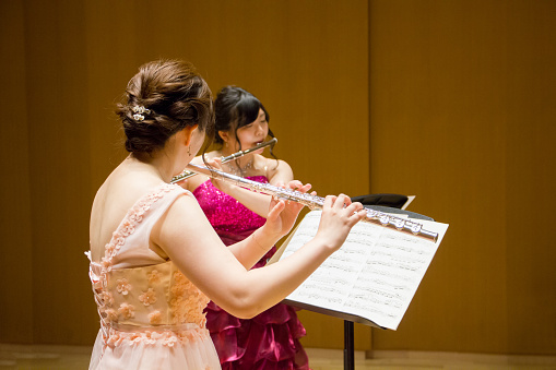 Women Playing Flute In A Concert Stock Photo - Download Image Now