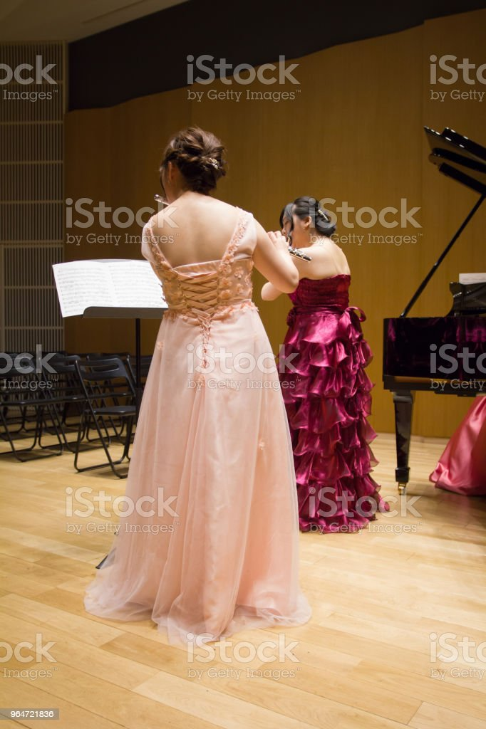 Women Playing Flute in a Concert, Rehearsal royalty-free stock photo