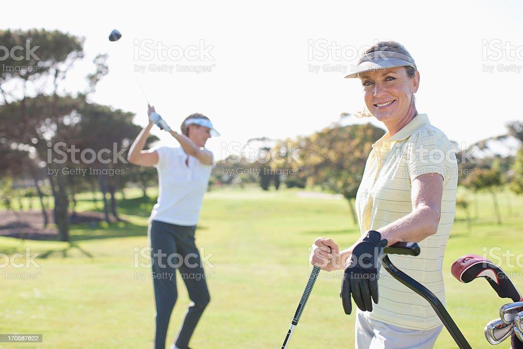 Women playing golf royalty-free stock photo