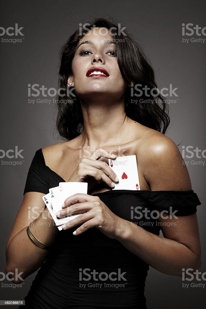women playing poker, hiding an ace up his sleeve stock photo