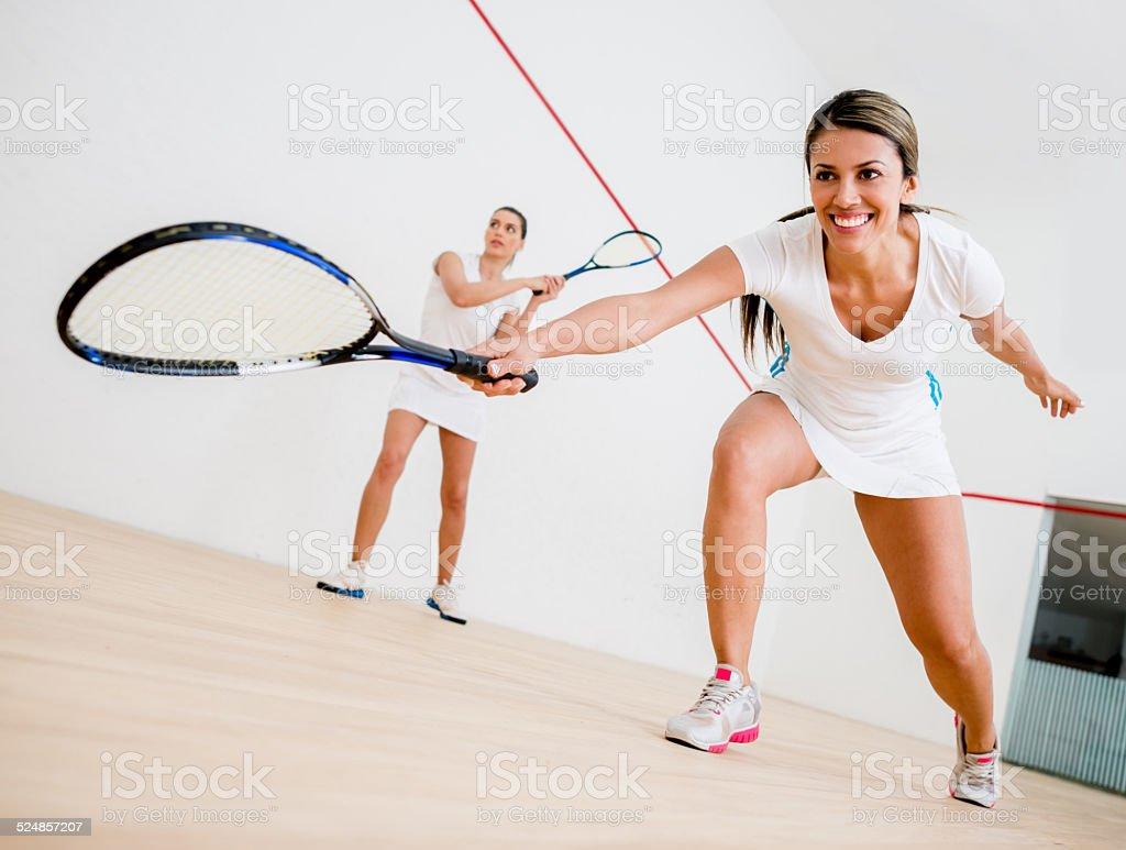 Women playing squash stock photo
