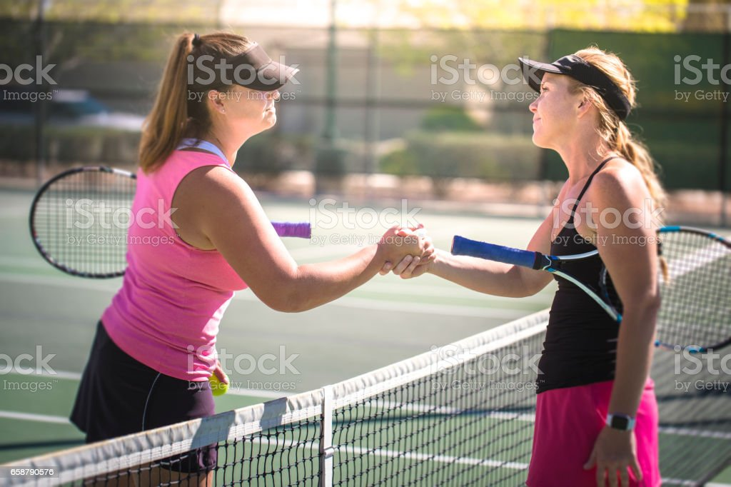 Women Playing Tennis stock photo