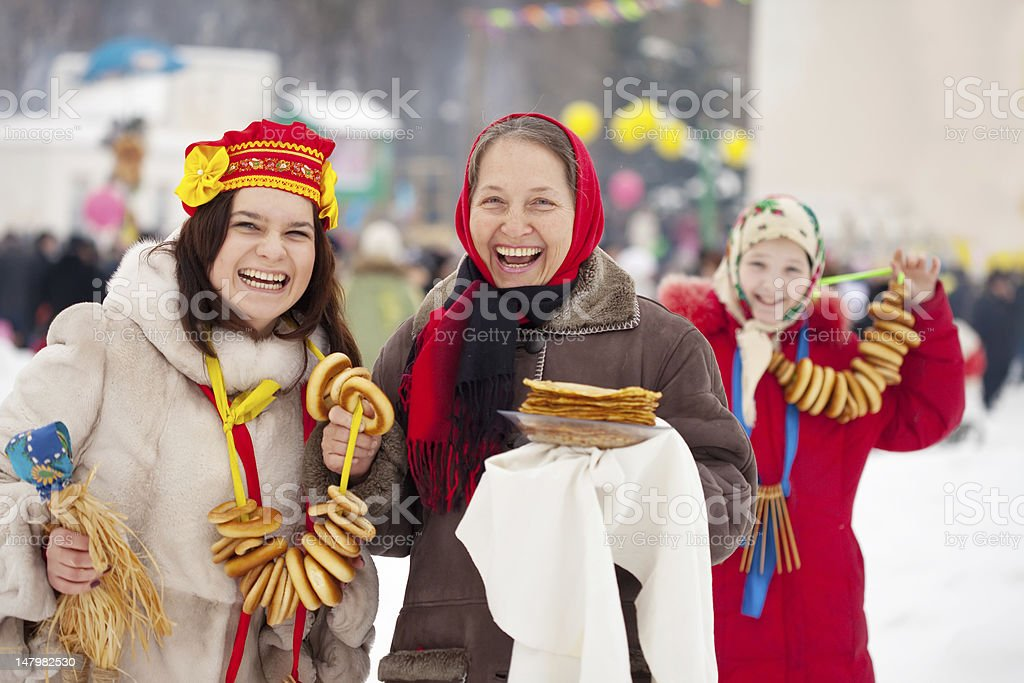 women plays during Pancake Week stock photo