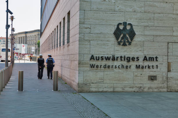 Women police patrol Ministry of Foreign Affair in Berlin, Germany. BERLIN, GERMANY - JULY 14,2018: Women police patrol the street and Ministry of Foreign Affair in downtown. Berlin is the capital and German largest city by both area and population. foreign affairs stock pictures, royalty-free photos & images