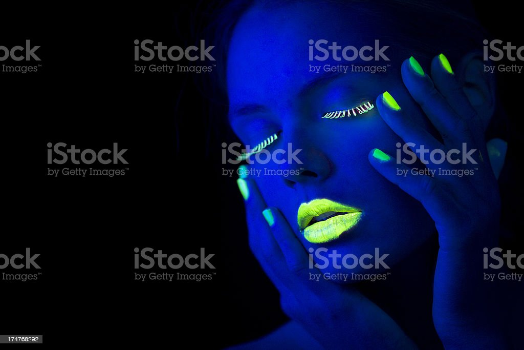 Women Portrait in Neon Light with Lime Green Fingernails royalty-free stock photo