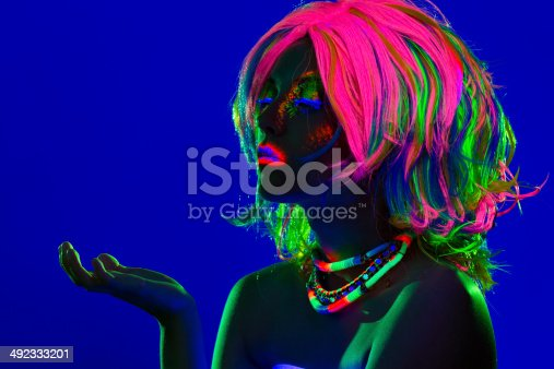 1071416330 istock photo Women Portrait in Ultraviolet Light 492333201