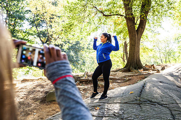 women posing post workout in central park new york - funny fat lady stock photos and pictures