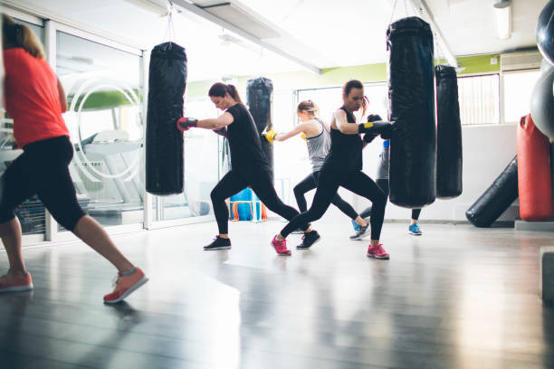 Women Practicing Boxing In The Gym stock photo