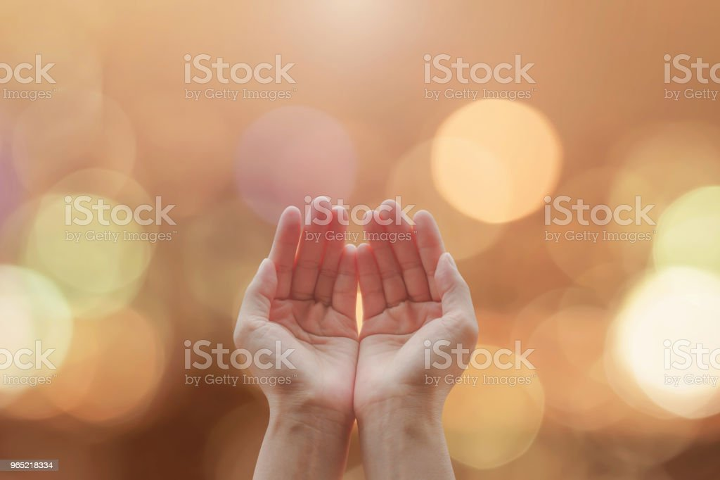 Women prayer hand praying with bokeh background for holy spirit and world religion day concept zbiór zdjęć royalty-free