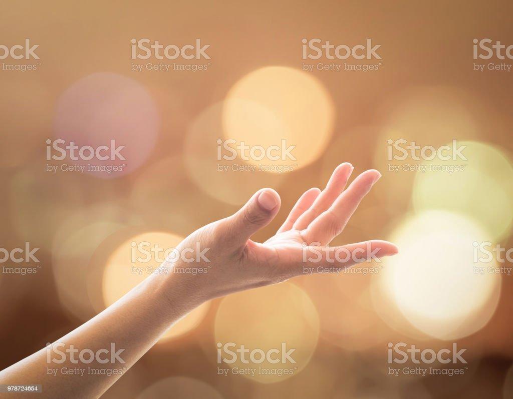 Women prayer hand reaching upward for holy spirit and world religion...