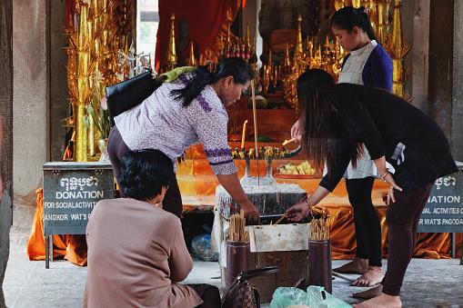 istock Women praying at Angkor Wat Temple 984366468