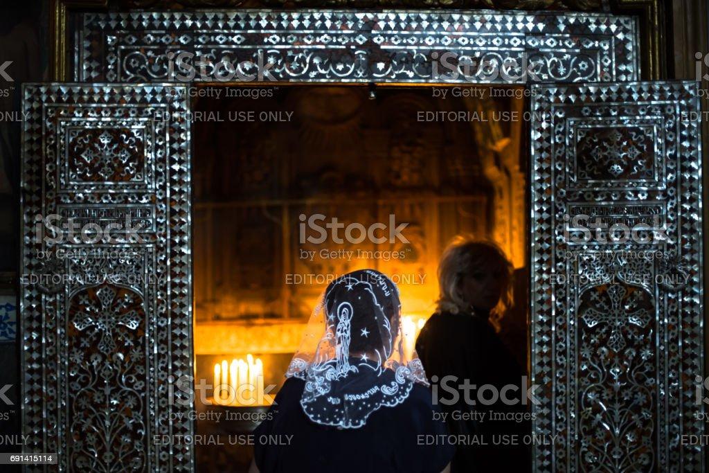 Women praying in Armenian Orthodox church stock photo
