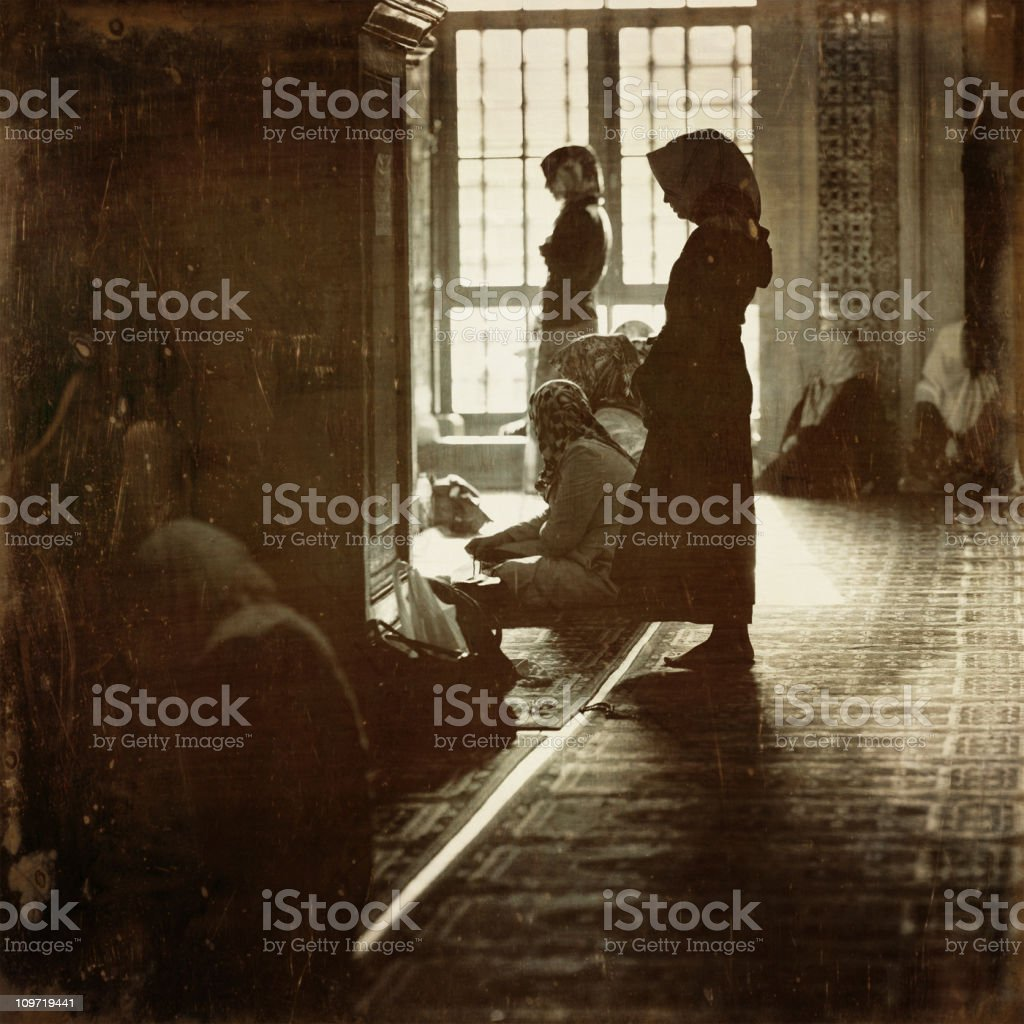 women praying in istanbul mosque royalty-free stock photo