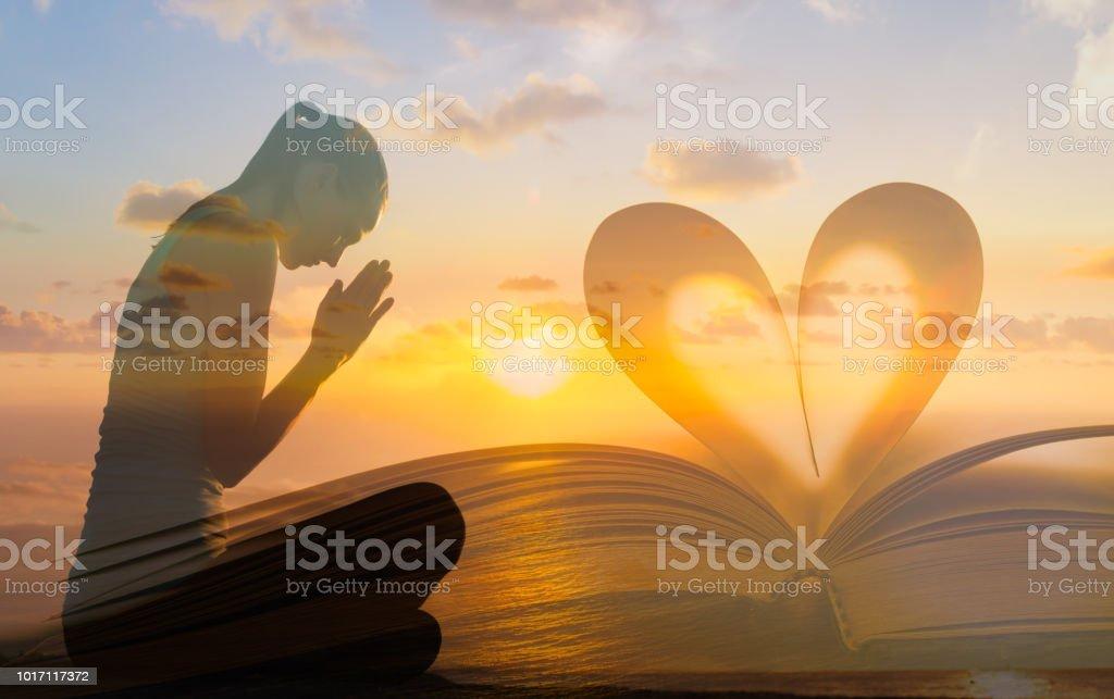 Women praying stock photo