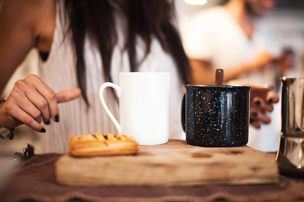 women prepares coffee close up - kaffeetasse tattoo stock-fotos und bilder