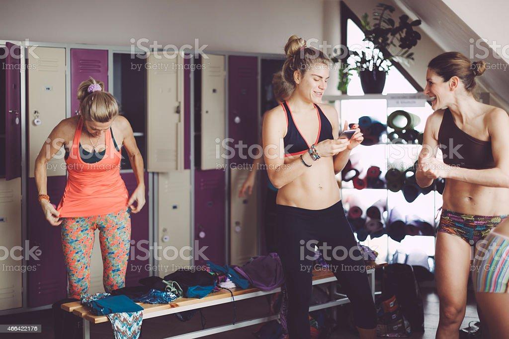 Women preparing for yoga in the dressing room stock photo