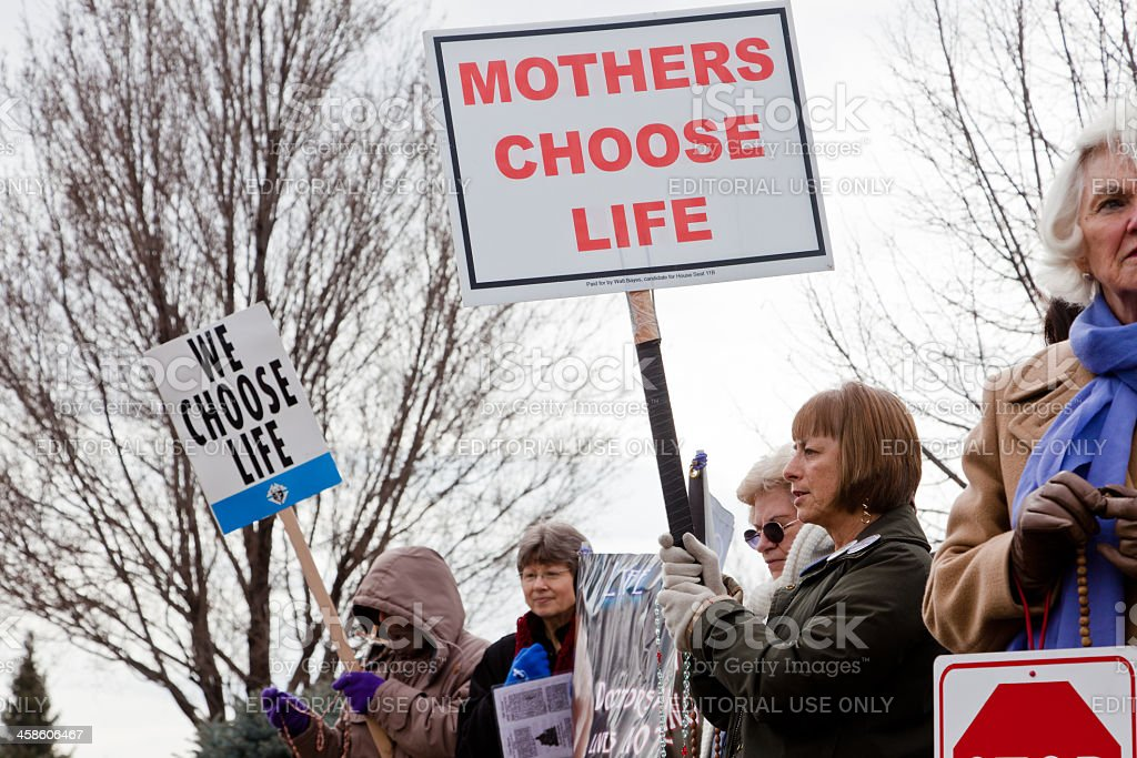 Women protesting against abortion Boise, Idaho, USA - March, 9 2011: Women protesting against abortion outside a family planning center Abortion Stock Photo
