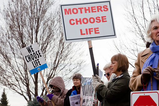 Boise, Idaho, USA - March, 9 2011: Women protesting against abortion outside a family planning center