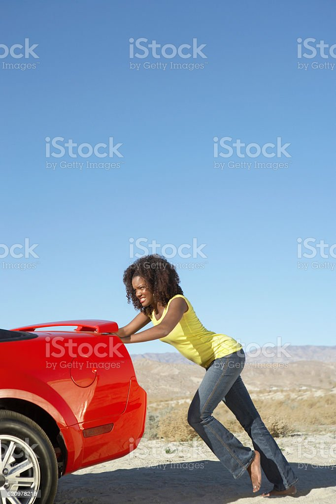 Women Pushing a Convertible stock photo